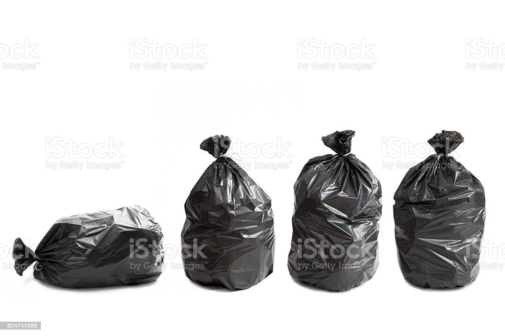 Four garbage bags stock photo