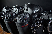 Four generations of Nikon camera bodies