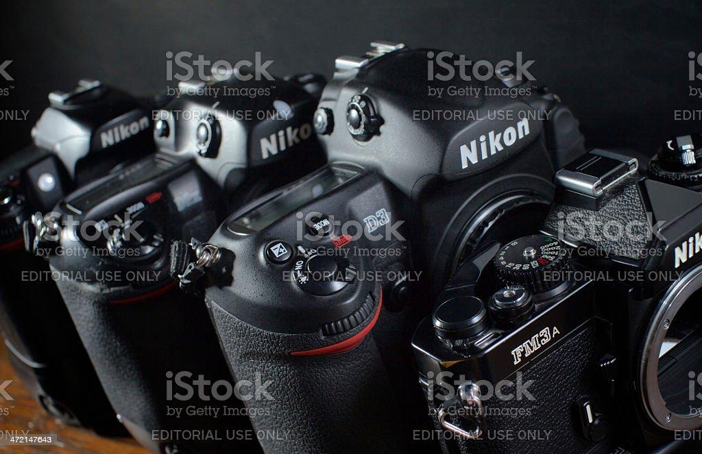 Four generations of Nikon camera bodies stock photo