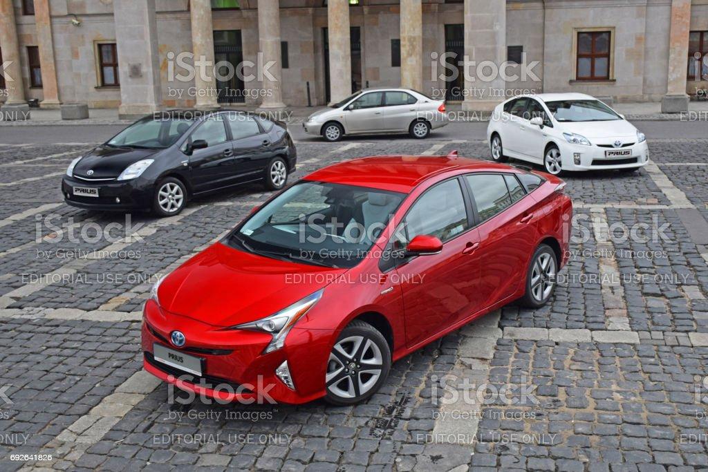 Four generations of Toyota Prius vehicles stock photo