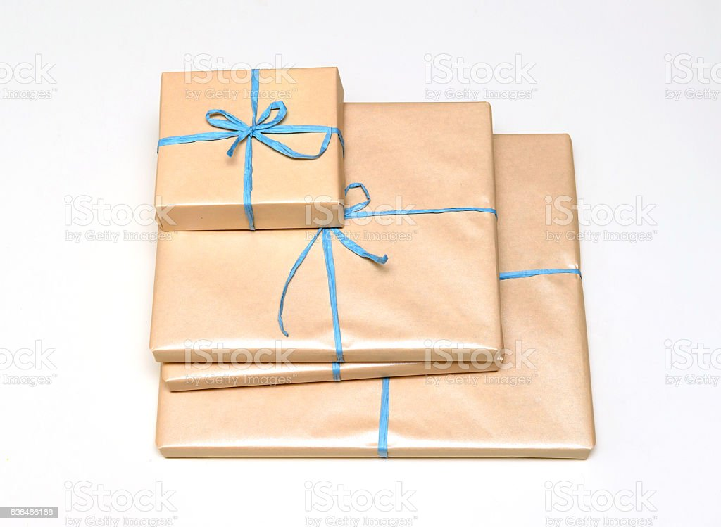 Four wrapped gift boxes ready to be distributed for any occasion,...