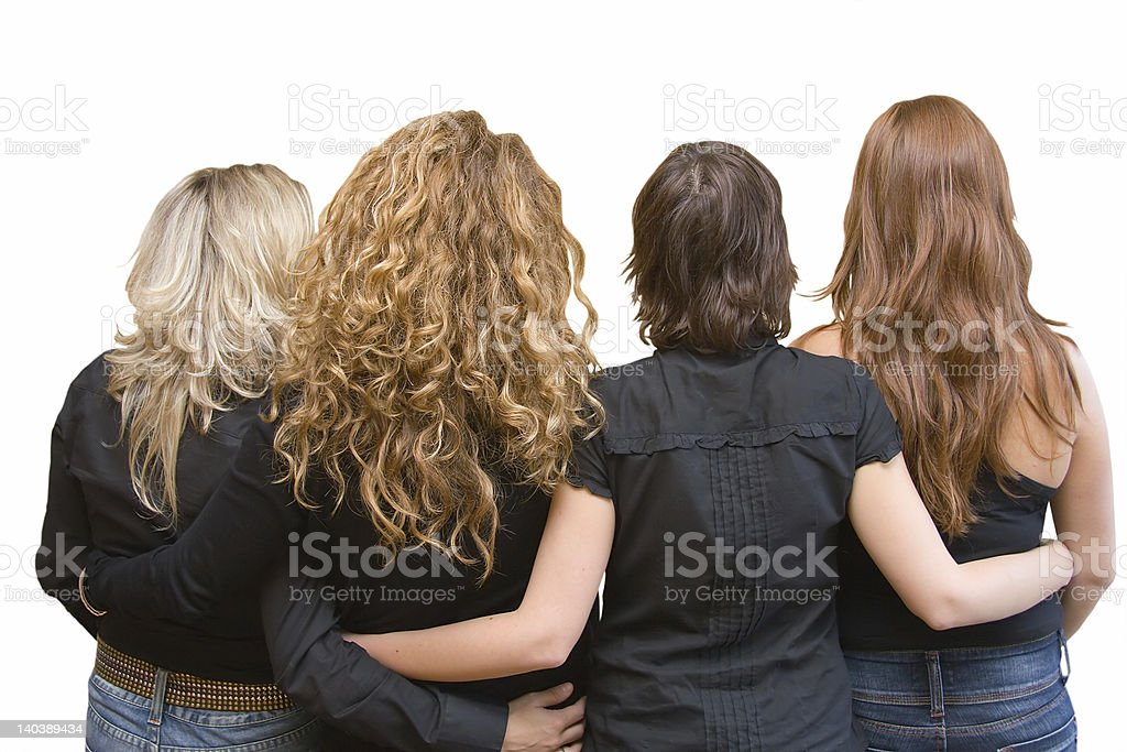 Four girls, 4 hair colours - linking arms stock photo