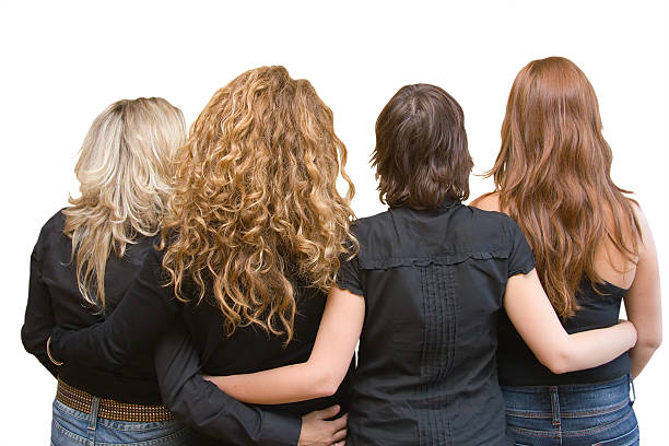 four girls, 4 hair colours - linking arms - row of heads stock photos and pictures