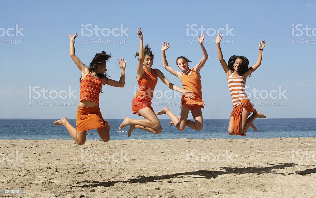 Four girls jumping - Royalty-free Beach Stock Photo