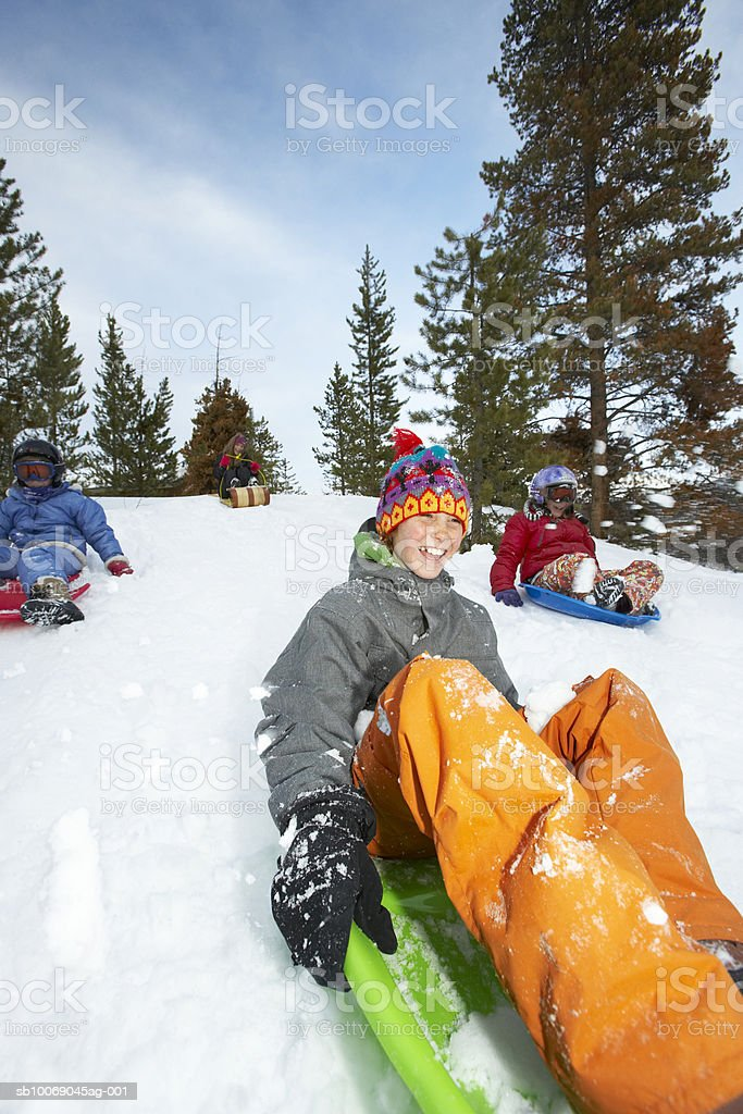 Four girls (8-13) on sled royalty-free stock photo