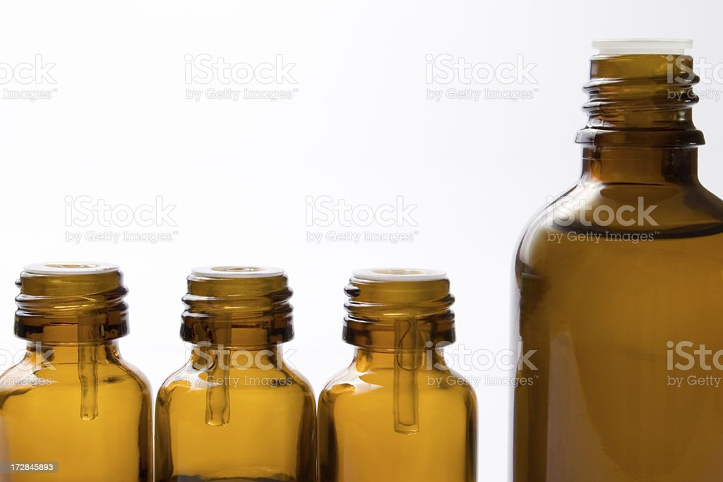 Four glass bottles royalty-free stock photo