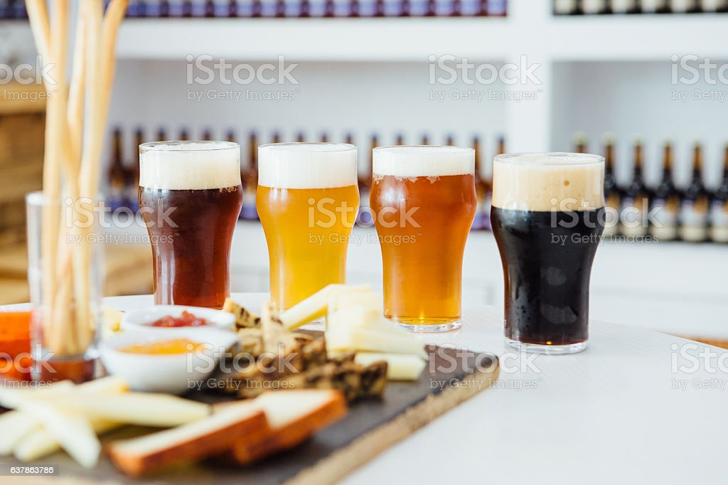 Four glasses of different craft beer - foto de acervo