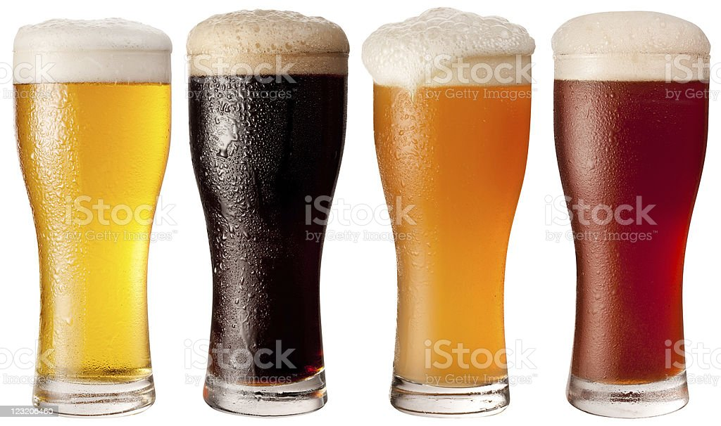 Four glasses with different beers. stock photo