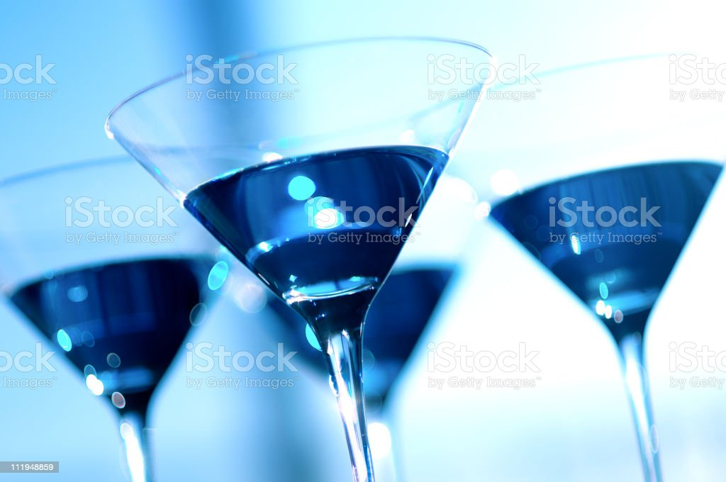 Four Glittering Blue Martinis Glasses on Surreal Background royalty-free stock photo