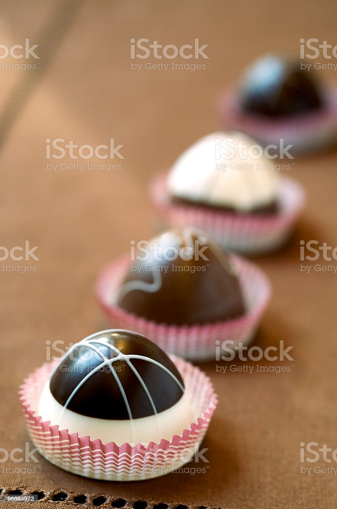 Four Gourmet Chocolate Truffles on Brown royalty-free stock photo