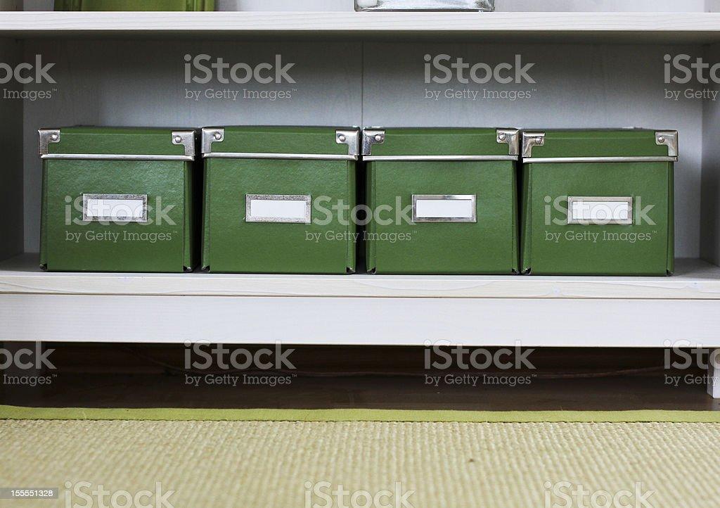Four green boxes stock photo