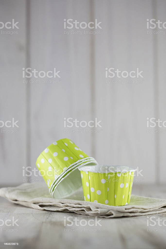 Four green cupcake liners and muffin stock photo