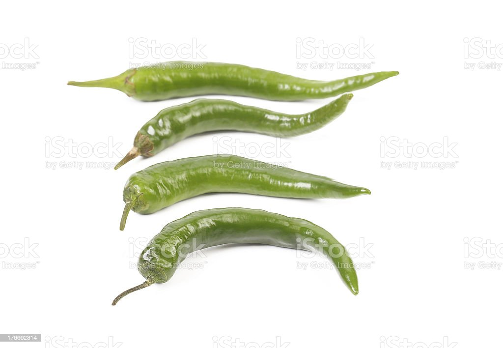 Four green peppers royalty-free stock photo