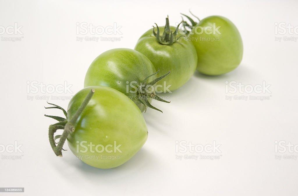 Four Green Tomatoes stock photo