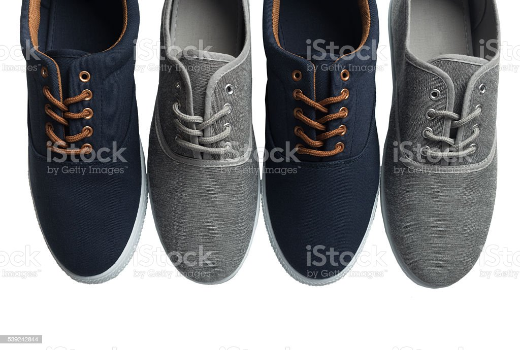 Four grey and blue sneakers isolated royalty-free stock photo