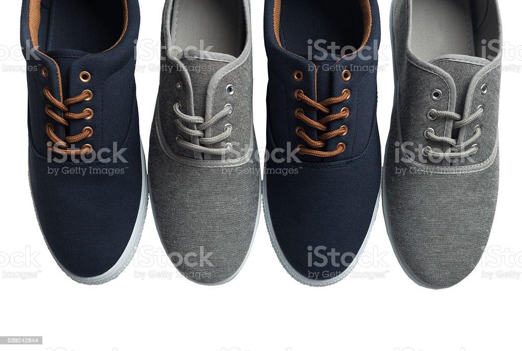 Cuatro Gris Y Azules Zapatillas Aislado Foto de stock y más banco de imágenes de A la moda