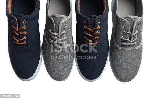 Fotografía de Cuatro Gris Y Azules Zapatillas Aislado y más banco de imágenes de A la moda