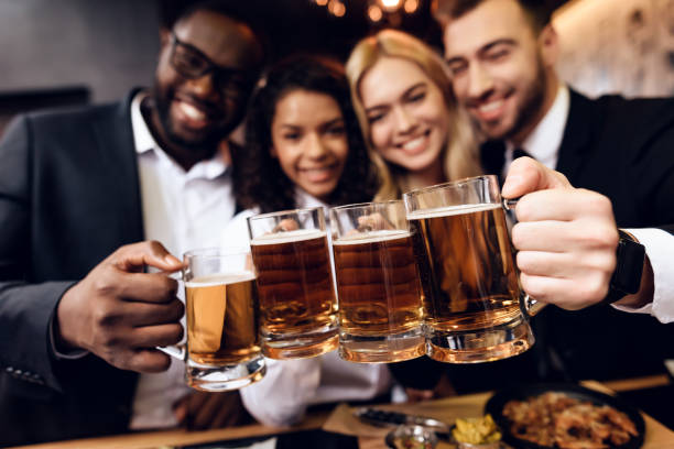 four guys and girls ordered a beer in the bar. - happy hour stock photos and pictures