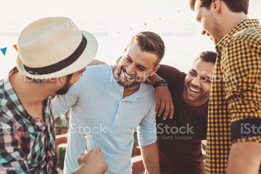 Four guys having fun stock photo