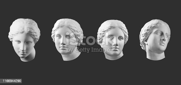 istock Four gypsum copy of ancient statue Venus head isolated on black background. Plaster sculpture woman face. 1166944290