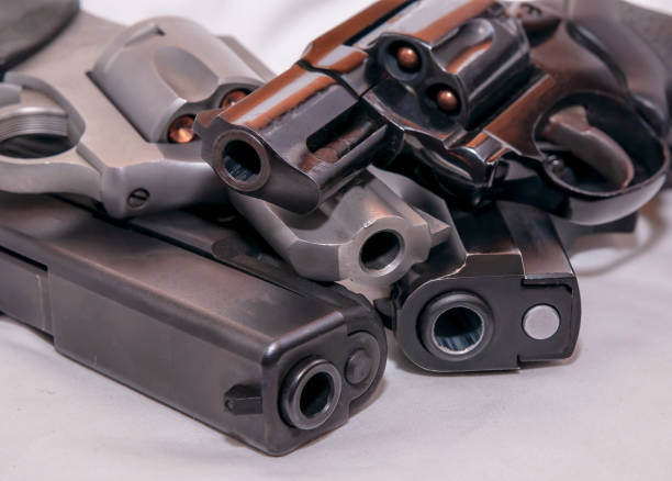 Four handguns, two pistols and two revolvers, a 9mm, 40 caliber, 357 magnum and a 38 special stock photo