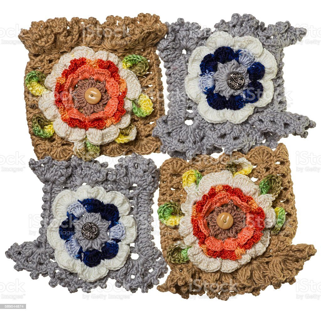 Four hand-knitted bracelets with flower stock photo