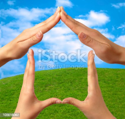 istock Four hands making the shape of a house - real estate concept 105616062
