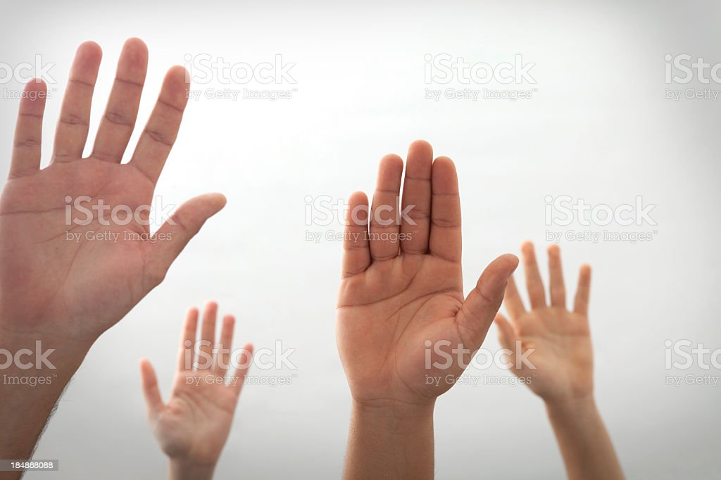 Four hands rises up on off white background stock photo