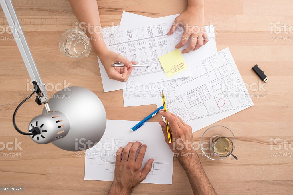 Four hands working on a desk royalty-free stock photo