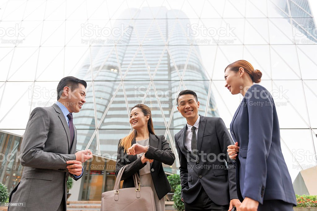 Four Happy Businessmen in Hong Kong Financial Centre, China, Asia stock photo