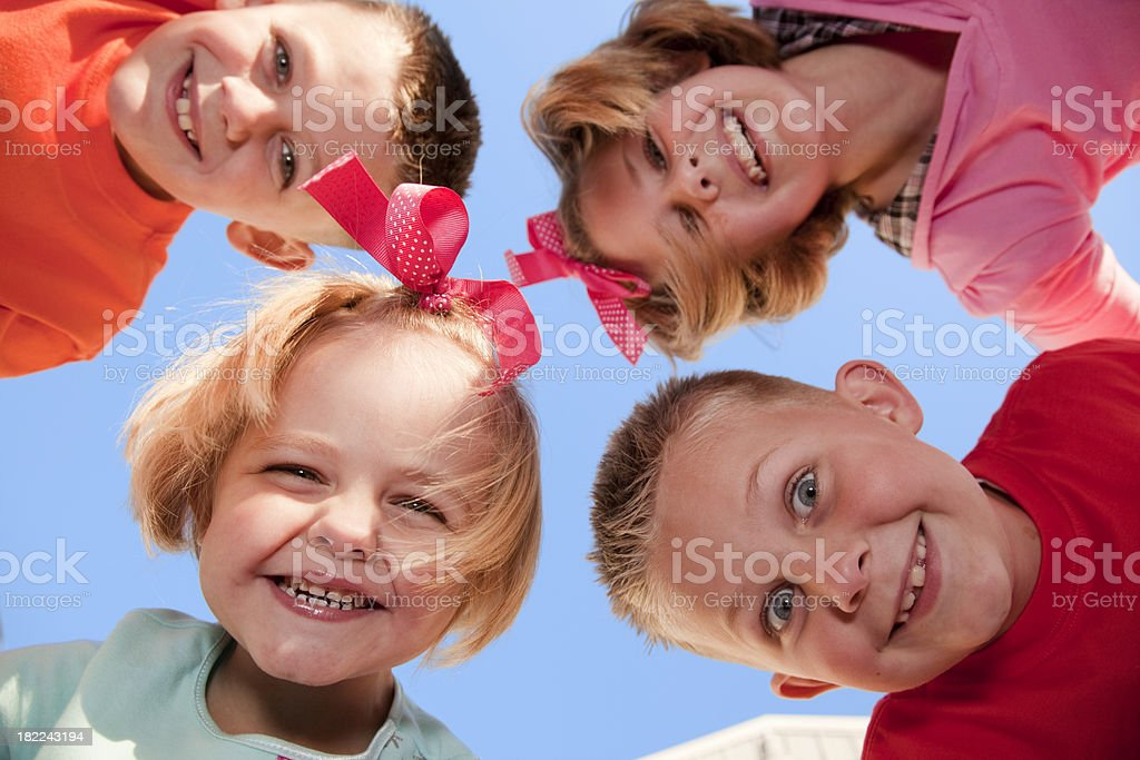 Four Happy Children Outdoors siblings royalty-free stock photo