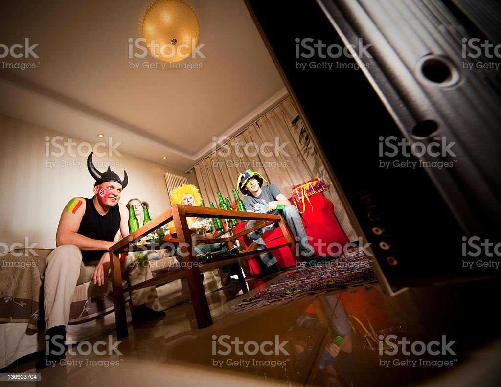 Four happy fans stock photo