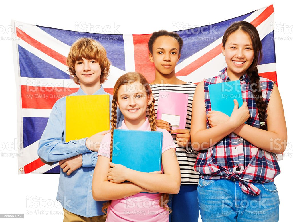 Four happy students standing against British flag stock photo
