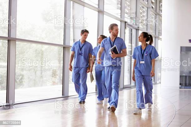 Four healthcare workers in scrubs walking in corridor picture id862725544?b=1&k=6&m=862725544&s=612x612&h=v5edoh8u ngvxp5at057if0brjrypms9pnfq5y3z6dy=
