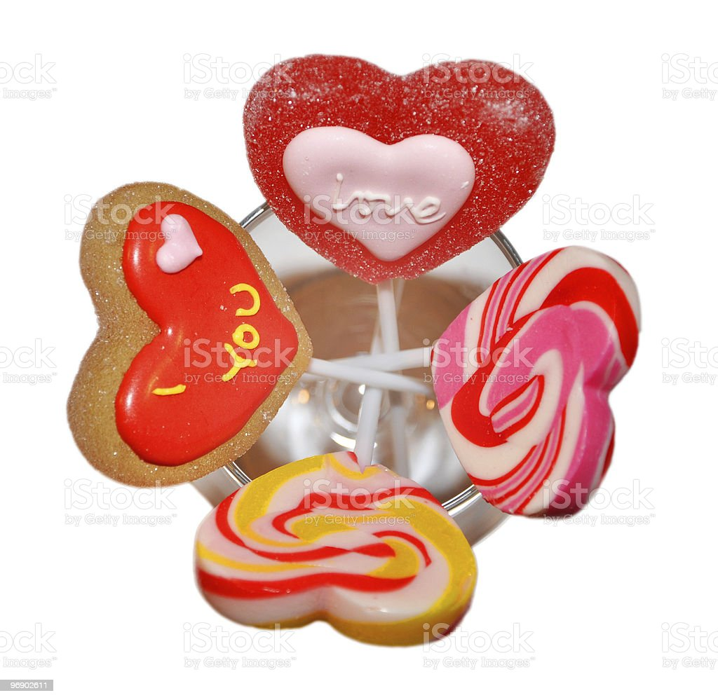 Four heart lollipos in a glass royalty-free stock photo