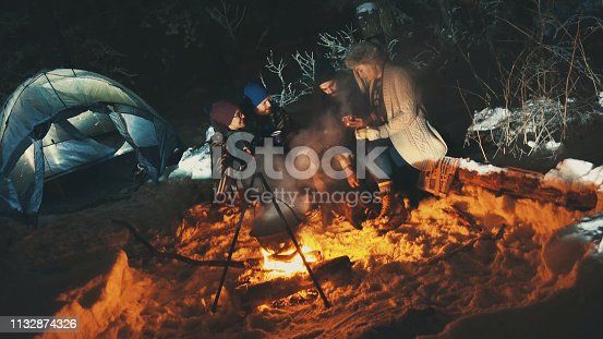 Four hipsters camping on mountain