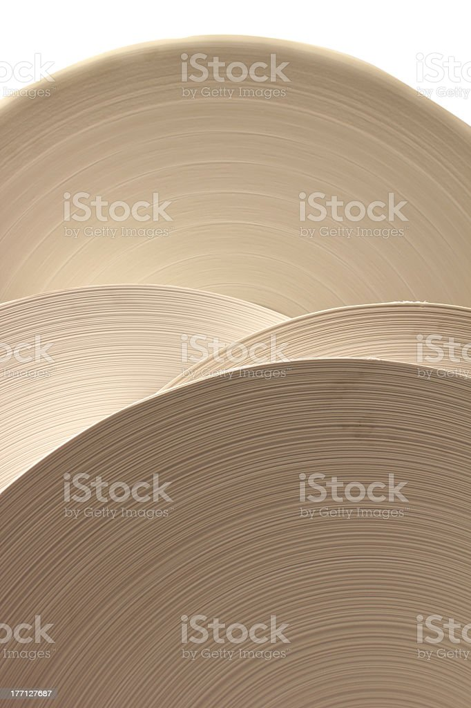 Four huge rolls of paper in a line stock photo
