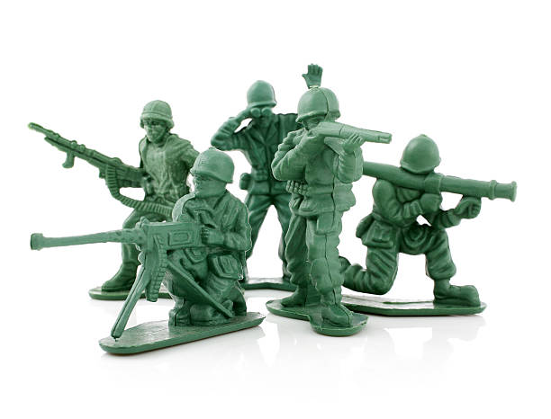 Four isolated toy soldiers on a white background stock photo