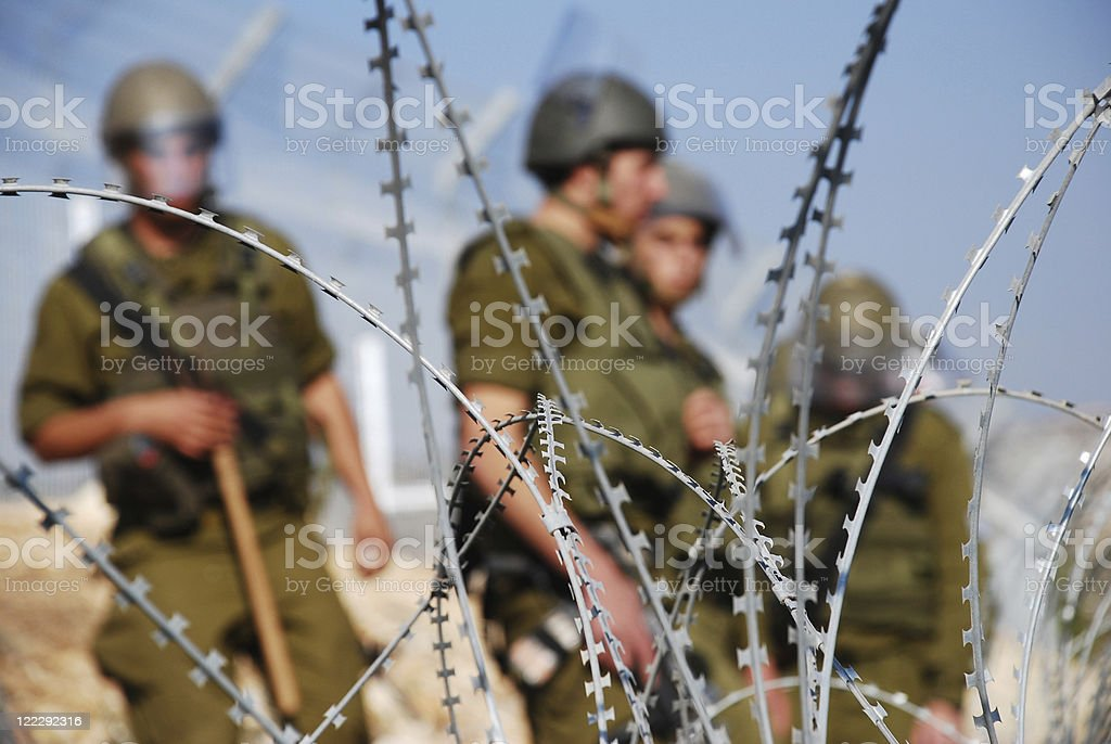 Razor Wire and Soldiers royalty-free stock photo