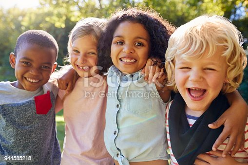 istock Four kids hanging out together in the garden 944585218