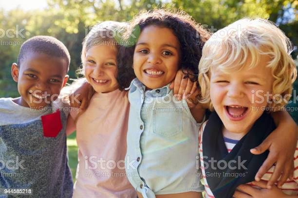 Four kids hanging out together in the garden