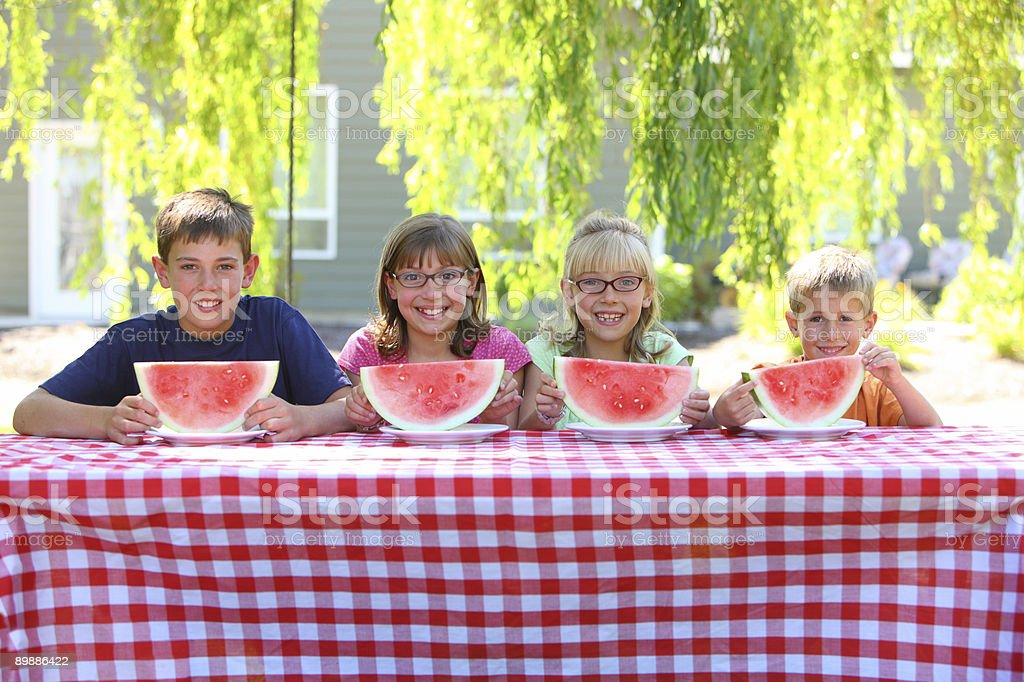 Four kids with watermelon royalty-free stock photo