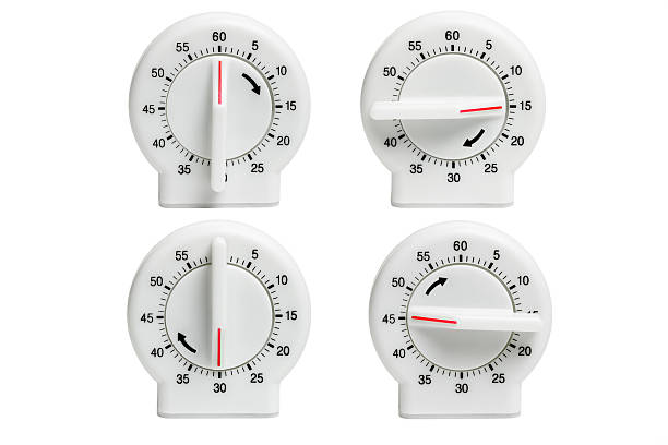 Four kitchen timers Collection of Kitchen timers showing dial setting at different times on white background timer stock pictures, royalty-free photos & images