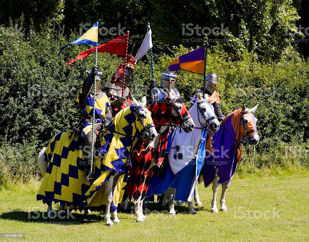 Four knights on horses, in a row stock photo