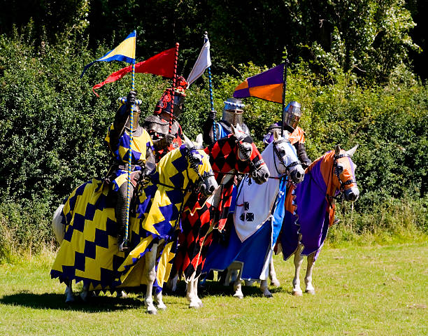 four knights on horses, in a row - knight on horse stock photos and pictures