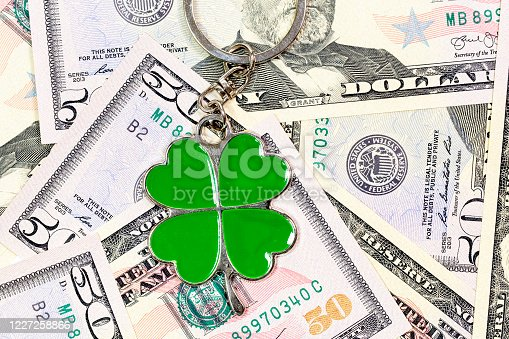 four leaf clover key chain and dollars