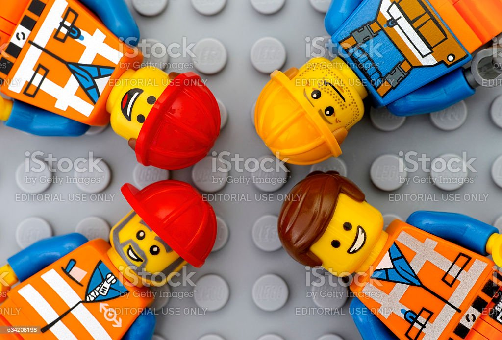Four Lego workers minifigures stock photo