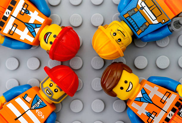four lego workers minifigures - lego stockfoto's en -beelden