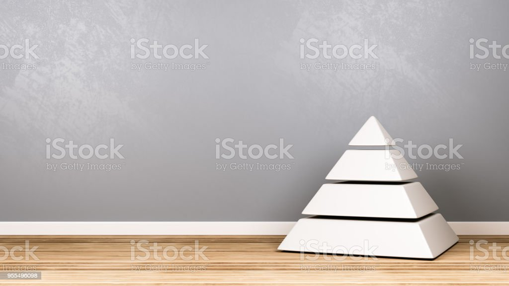 Four Levels White Pyramid on Wooden Floor Against Wall stock photo