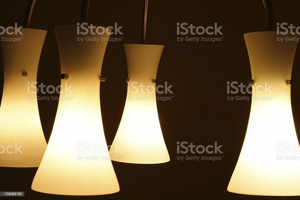 Four light fixtures on a dark background royalty-free stock photo